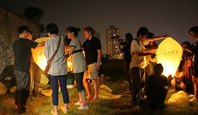 Artists prepare to launch Kongming lanterns, Here Comes the Sun, Zendai MoMA, Shanghai, China