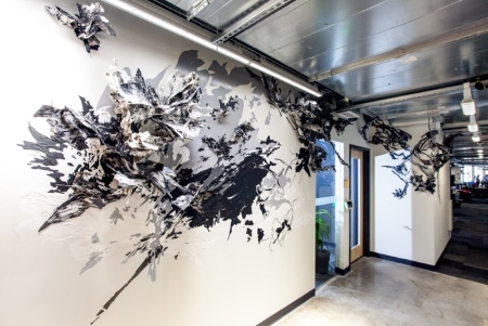 Debra Weisberg creates a drawing installation at the Facebook Cambridge Office. Photo by Simone Scheiss.