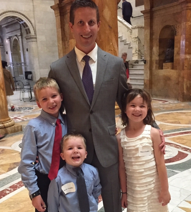 Stefan Lanfer and his children at a State House celebration of 2015 Mass Cultural Council Artist Fellowship awardees.