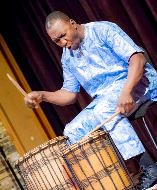 Sidi Joh Camara, newly named a Mass Cultural Council Traditional Arts Fellow, plays percussion at the Shalin Liu Performance Center in Rockport, May 2017.